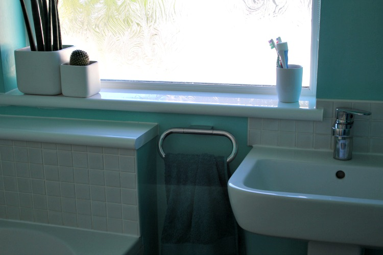 The bog and sink, new window and shelf to fill the gap at the end of the bath.