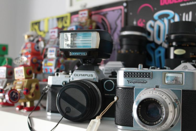 A collection of tin robots and a collection of vintage cameras*